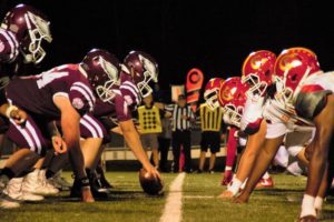offensive lineman stand in football